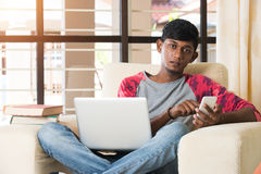 Teenage indian male using Royalty Free Stock Photography
