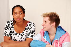 Teenage infatuation. College love, the girl reacts as young man admires her Royalty Free Stock Photo