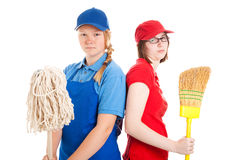Teenage Jobes - Boredom. Two teenage girls with their first jobs.  Both are bored and unhappy.  Isolated on white Royalty Free Stock Photos