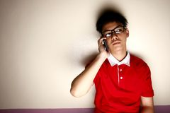 Teenage kid talking on a smartphone Royalty Free Stock Images