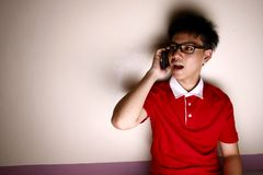 Teenage kid talking on a smartphone Royalty Free Stock Photo