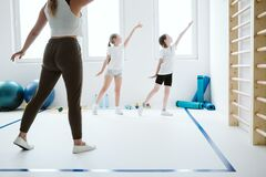 kids exercising during sport class at school gym