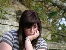 Teenage looks. Teenage girl with an upset or crying expression outside an abandoned building royalty free stock photos