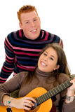 Teenage lovers with guitar Royalty Free Stock Image