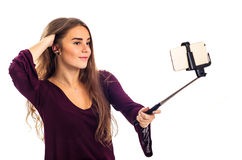 Teenage making self-portrait with selfie stick Royalty Free Stock Image