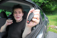 Teenage male showing excitement behind the wheel Stock Photos