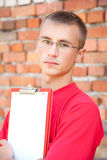 Teenage male student with blank clipboard Royalty Free Stock Photography