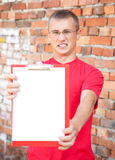 Teenage male student with blank clipboard Stock Photo