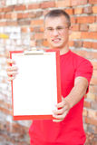 Teenage male student with blank clipboard Royalty Free Stock Photo