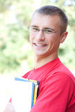 Teenage male student with books Stock Image