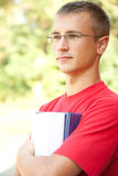 Teenage male student with books and notepads Royalty Free Stock Photo