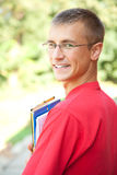 Teenage male student with books and notepads Royalty Free Stock Image