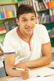Teenage Male Student In Classroom Royalty Free Stock Photography