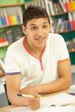 Teenage Male Student In Classroom. Teenage Male Student Working In Classroom Royalty Free Stock Photography