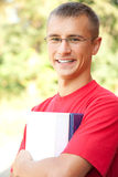 Teenage male student outdoors Royalty Free Stock Photo