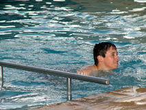 Teenage male swimming. Male teenager swimming in pool Royalty Free Stock Images