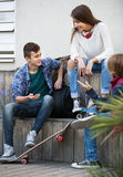 Teenage males and girl talking. Portrait of teenage males and american girl talking in autumn day Royalty Free Stock Photos