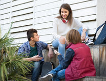 Teenage males and girl talking Royalty Free Stock Photos