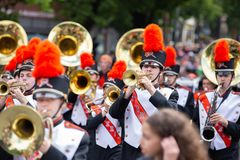 Teenage marching band with flutes and tubas. Portland, OR / USA - June 11 2016: Marching `Tigers` band in uniform costumes with tuba and trombone musical royalty free stock photos