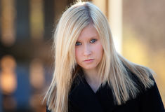 Teenage Model in Black Jacket. A portrait of an attractive teenager looking defiantly at the viewer Stock Photo