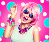 Teenage model girl with pink hair. Beauty teenage model girl with pink hair, fashion colorful accessories and sunglasses Royalty Free Stock Image