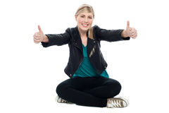 Teenage model showing double thumbs up Stock Photography