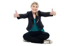 Teenage model showing double thumbs up Stock Photography