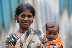 Teenage Mom. A portrait of a poor Indian lady in her late teens with her baby boy Royalty Free Stock Photography