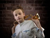 Young Male Violinist portrait against brick wall. Teenage musician posing for portrait against old brick wall taking easy Royalty Free Stock Image