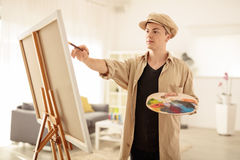 Teenage painter painting on a canvas stock photo