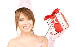 Teenage party girl with magic wand and gift box Stock Photos