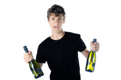 Teenage partying with two bottles of wine. Isolated on white royalty free stock images