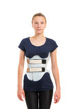 Teenage patient in corset Chenault isolated on white background Royalty Free Stock Photo