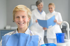 Teenage patient at dental surgery dentist nurse Royalty Free Stock Image