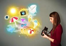 Teenage photographer making photos of holiday painted icons Stock Photo