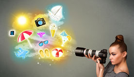 Teenage photographer making photos of holiday painted icons Royalty Free Stock Photos
