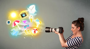 Teenage photographer making photos of holiday painted icons Stock Photos