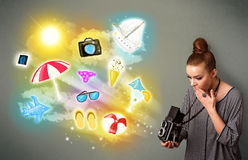 Teenage photographer making photos of holiday painted icons Stock Images
