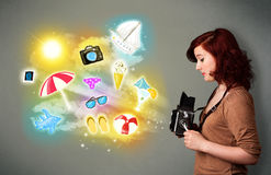 Teenage photographer making photos of holiday painted icons Royalty Free Stock Image
