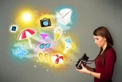 Teenage photographer making photos of holiday painted icons Stock Image