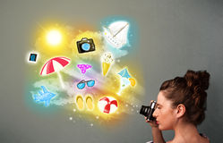 Teenage photographer making photos of holiday painted icons Royalty Free Stock Photography
