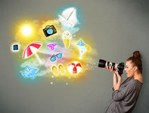 Teenage photographer making photos of holiday painted icons Royalty Free Stock Images