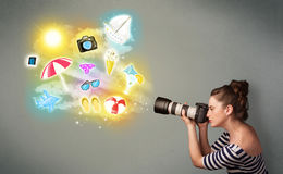 Teenage photographer making photos of holiday painted icons Stock Photography
