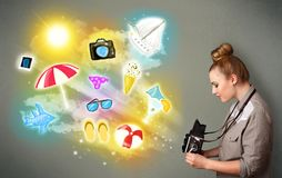 Teenage photographer making photos of holiday painted icons. Beautiful teenage photographer making photos of holiday painted icons Stock Photos