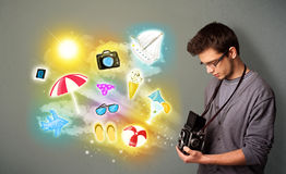Teenage photographer making photos of holiday painted icons Royalty Free Stock Photo