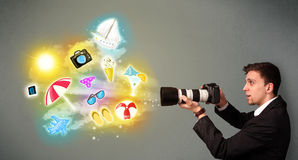 Teenage photographer making photos of holiday painted icons Stock Image