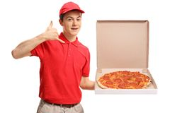 Free Teenage Pizza Delivery Boy Holding A Pizza Box And Making A Call Royalty Free Stock Photo - 106580925