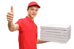 Teenage pizza delivery boy with a stack of pizza boxes making a Stock Images