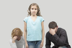 Teenage problems. Father and mother misunderstand their teenage girl standing separated from each other needed support and dialog isolated over white background stock photography