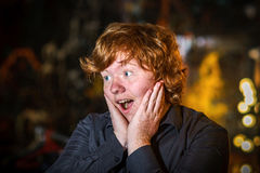 Teenage red-haired freckled boy showing wondering Stock Images